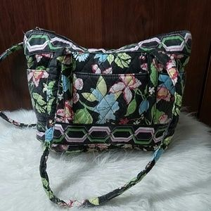 Pink, green, and black floral quilted shoulder bag